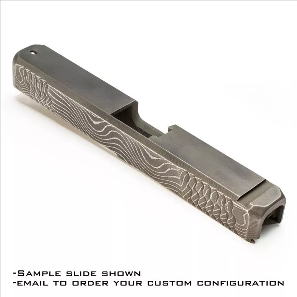 "Damascus steel slide with patterns folded to display on sides of slide. *Example of possible finished configuration featuring: front and rear bull nose, front and rear ""Wave"" style serrations and 45 degree edge bevels."